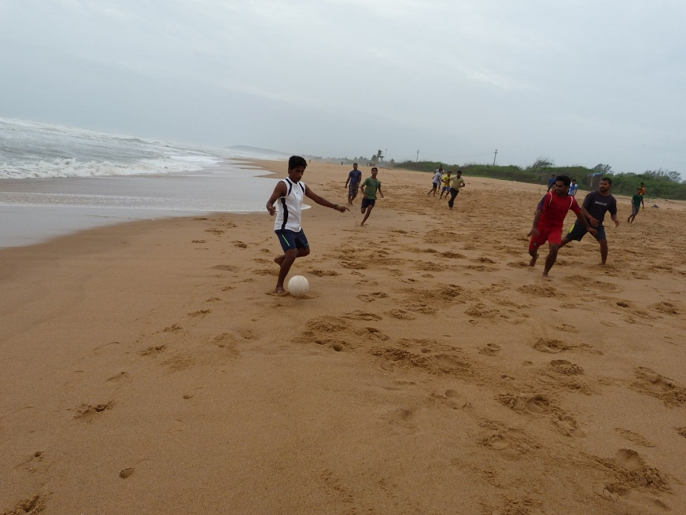 Playing Football on the beach in Goa