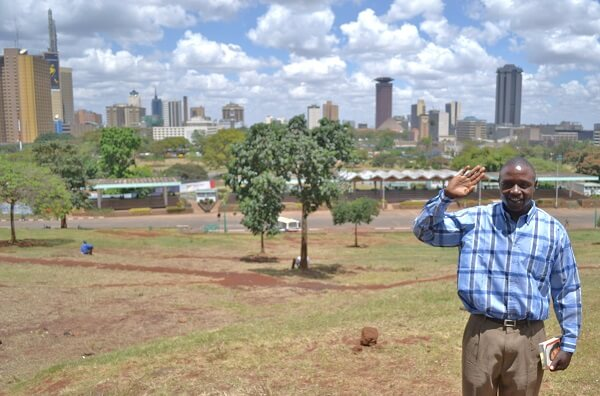 Charles in Uhuru Park and the Nairobi skyline