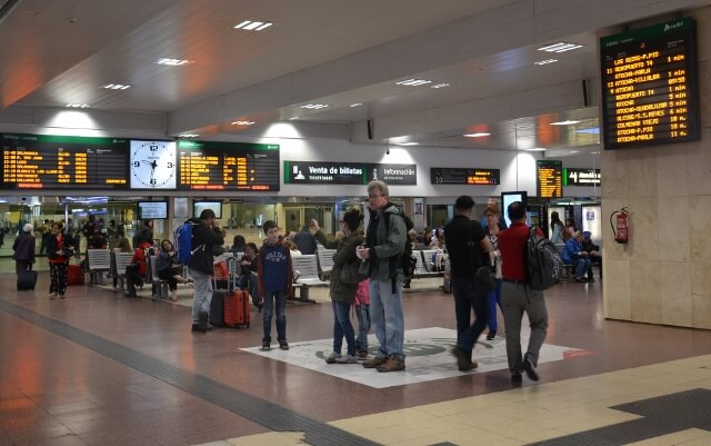 Buying train ticket for Segovia in Chamartin train station in Madrid