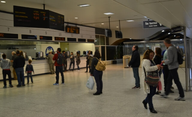 Buying tickets in Chamartin train station in Madrid