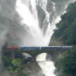 Train passes underneath the Dudhsagar Falls