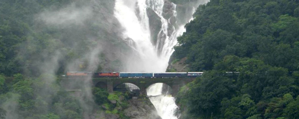 Train passes underneath the Dudhsagar Falls