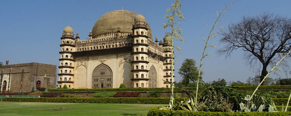 visiting the Gol Gumbaz Mausoleum