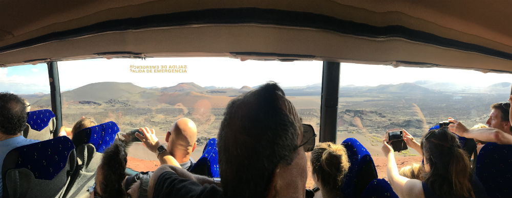People on the bus ride enjoying the view of Timanfaya National Park