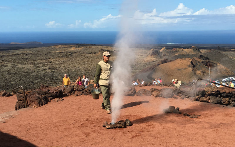 Steam blows from a volcano in Timanfaya National Park