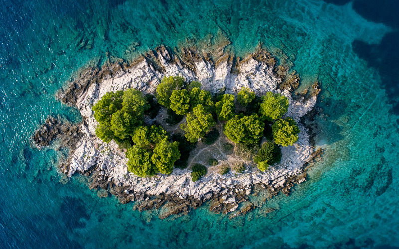 amazing photo of an island from above taken while traveling with a drone