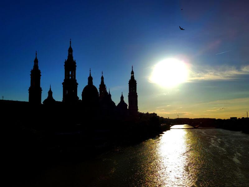 The sun starts to set over the Ebro river in Zaragoza