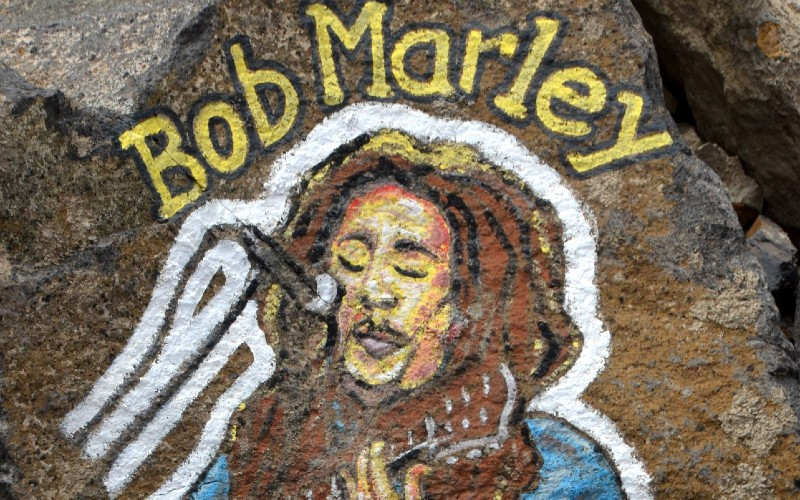 Bob Marley artwork painted on a rock.