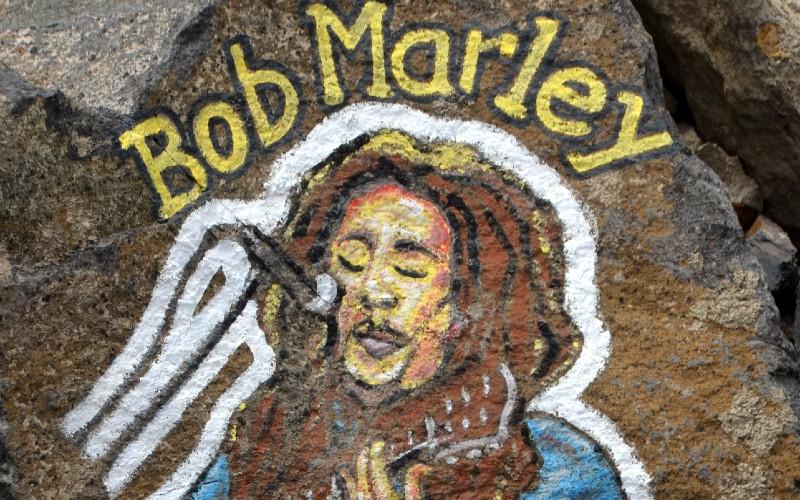 Bob Marley artwork painted on a rock.