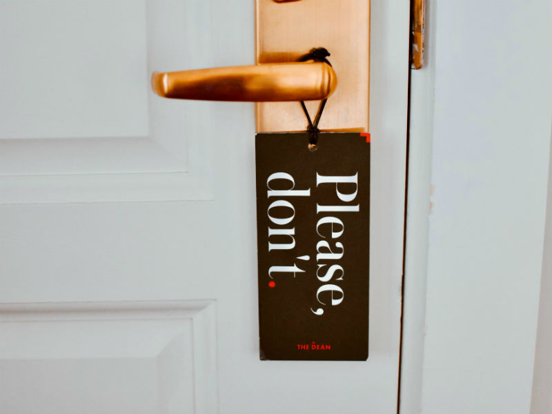 A do not disturb sign hanging froma hotel room door