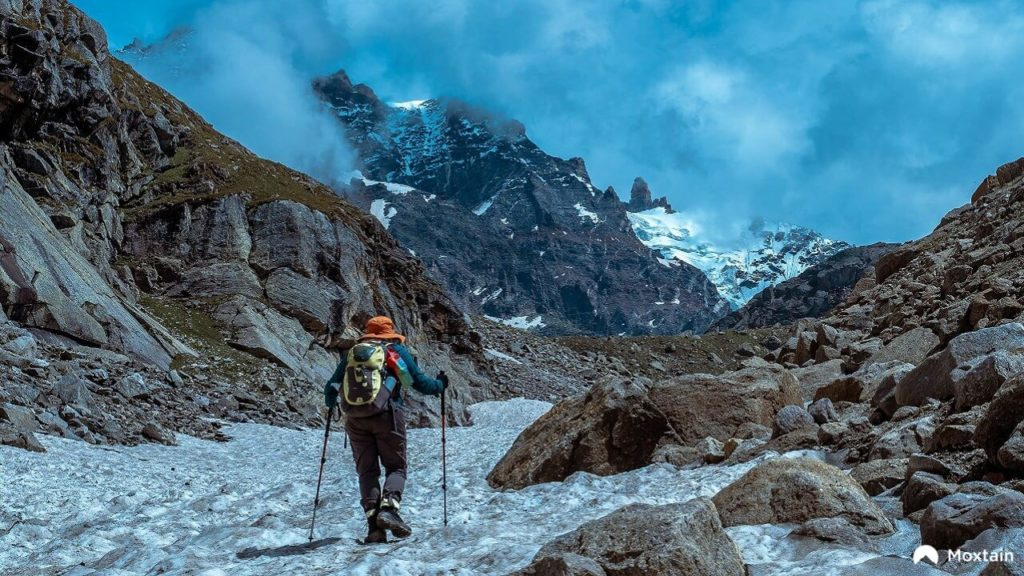 A beginner trekker on the Hampta Pass Trek in the Himalayas