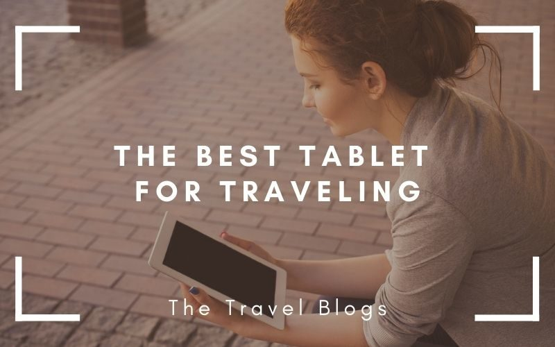 Lady sat reading on a tablet while traveling