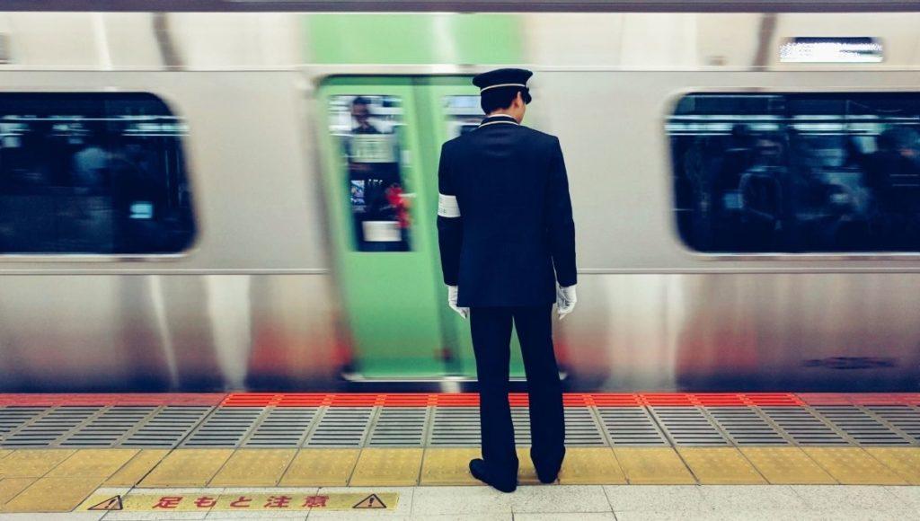 Guard watching a train in Tokyo