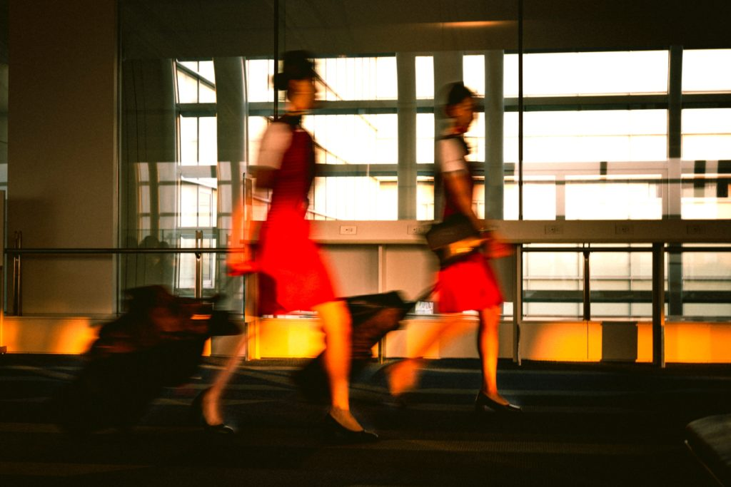 Air stewardesses walking through an airport in Tokyo