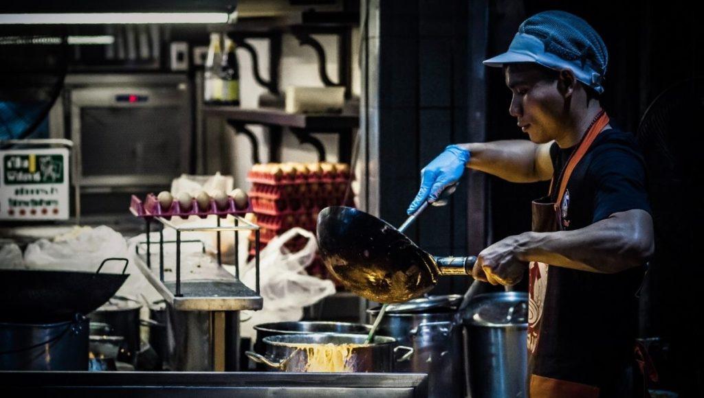 A man cooking street food in Bangkok