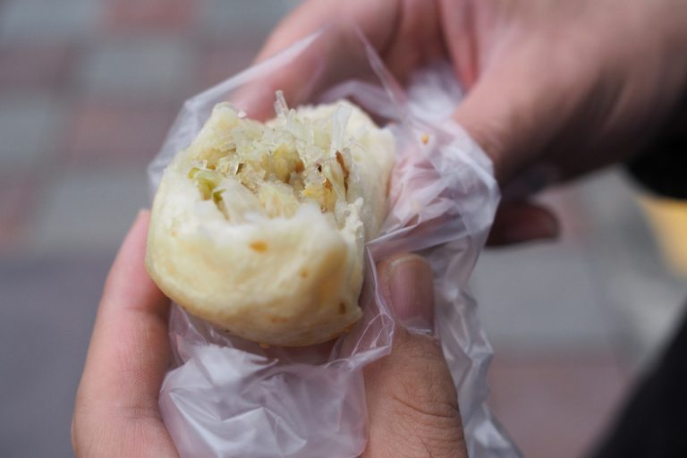Me eating some dumplings in Taiwan as part of my 2 Days In Taipei Itinerary