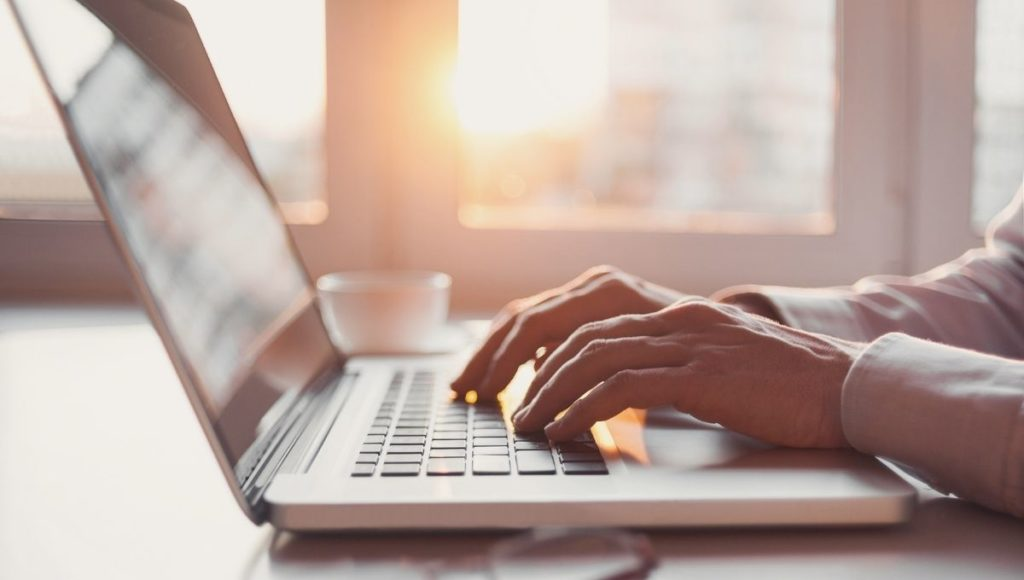 A lady typing on one of the Best Laptops For Writers