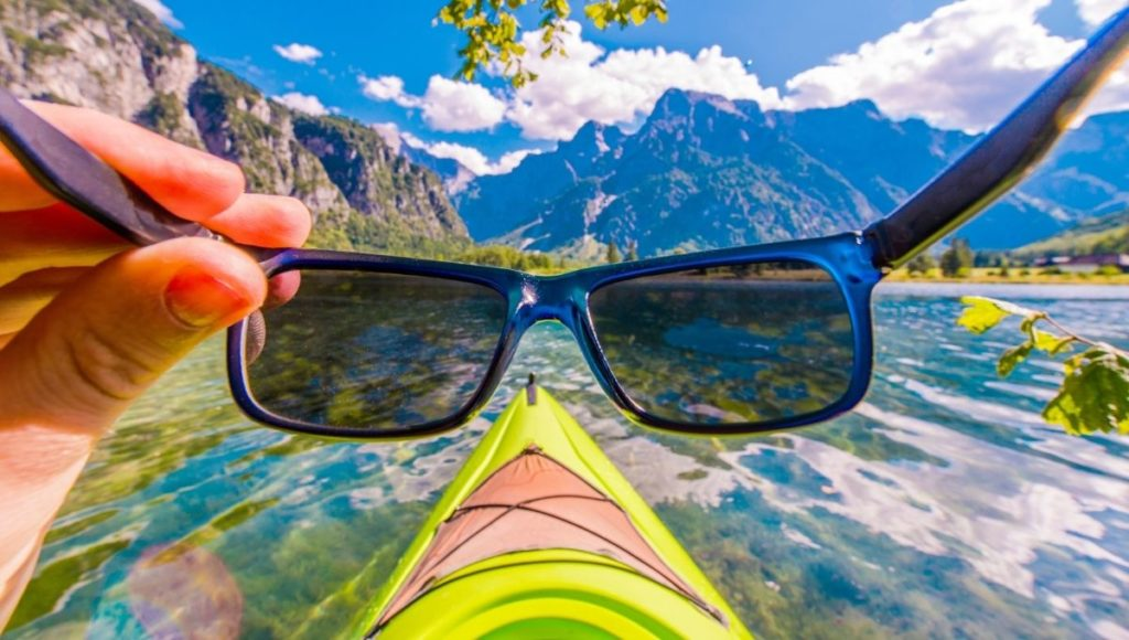 Sunglasses being used while kayaking to stay safe from the sun