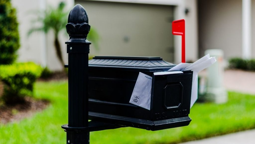 A mailbox crammed full of letters