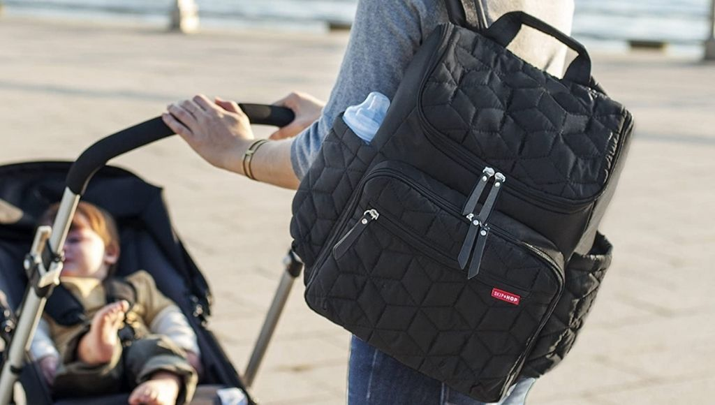 A mother carries diaper bags for traveling