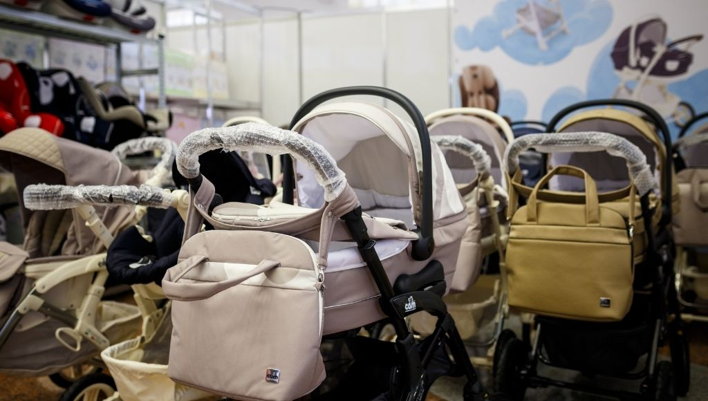 Variety of baby carriages and strollers in kids mall