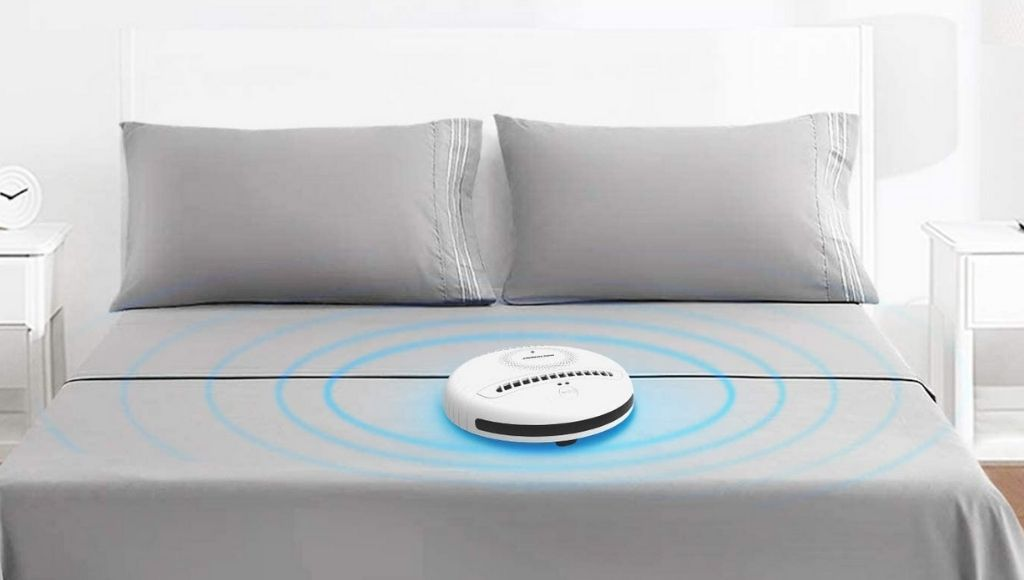 A rockubot bed cleaning robot cleaning a bed