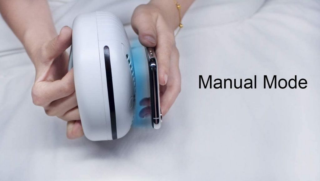 A man connecting her smartphone with rockubot bed cleaning robot