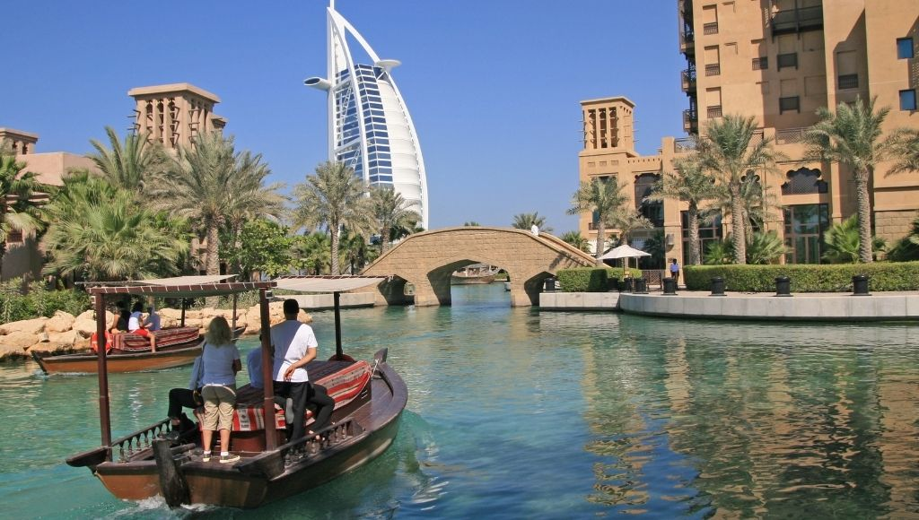 Tourists tour dubai by boat