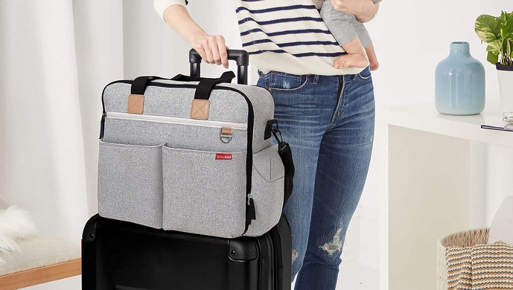 A woman pack her baby's diaper bag for traveling