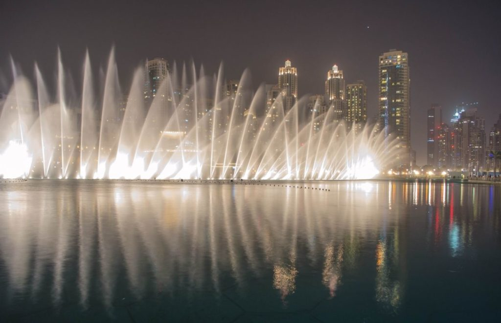 A photo of the Palm Fountains at night